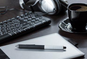 laptop, headphones, computer keyboard, coffee