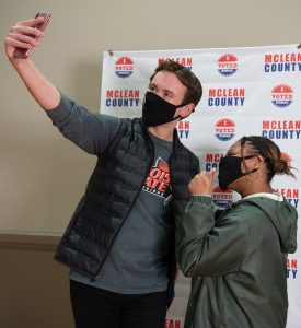 Students taking a selfie after voting