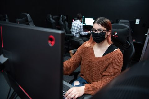 Student playing video games in computer lab