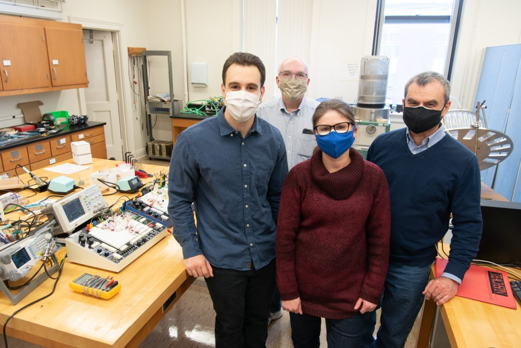 From left, Zach Mobille '19, Dr. George Rutherford, Dr. Rosangela Follmann, and Dr. Epaminondas Rosa, pictured in their laboratory.