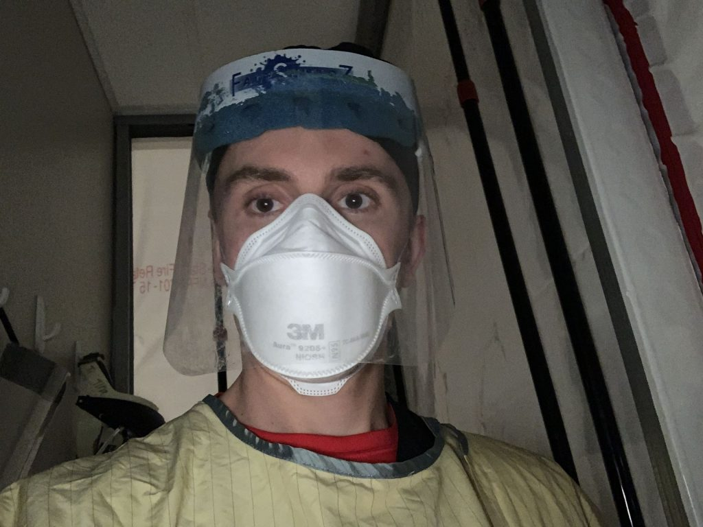 MCN faculty Harrison Krebs in PPE for an ICU shift during Winter Break.