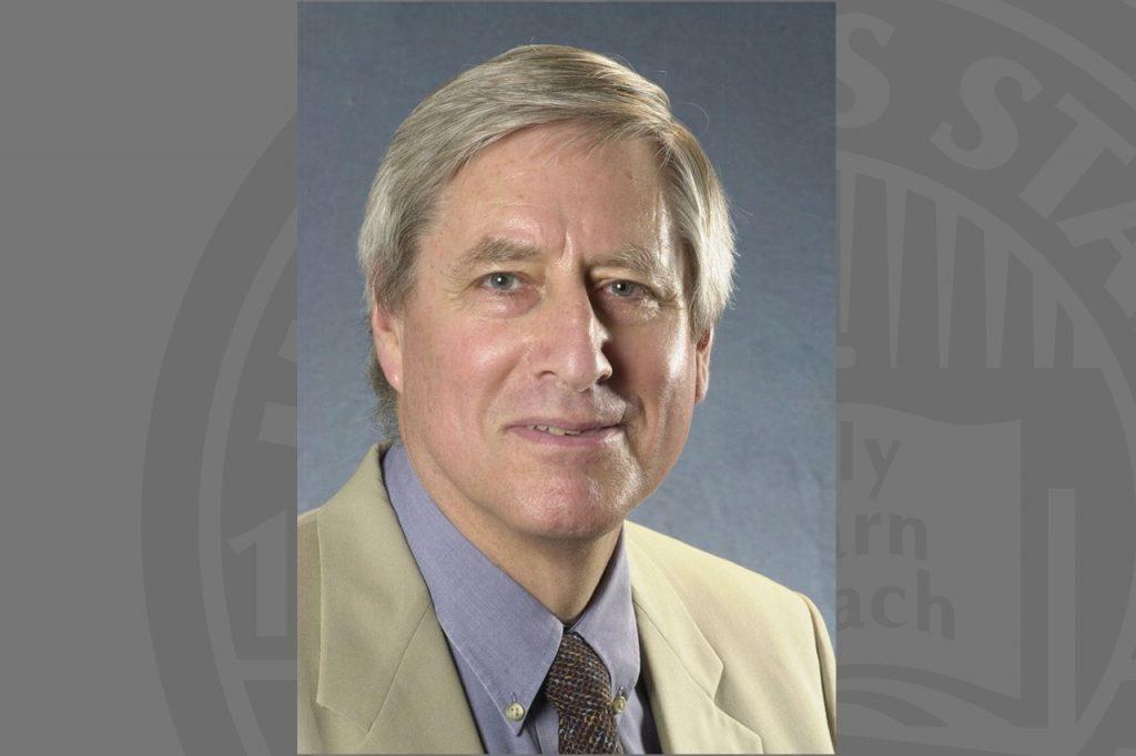 Portrait photo of man in tan suit