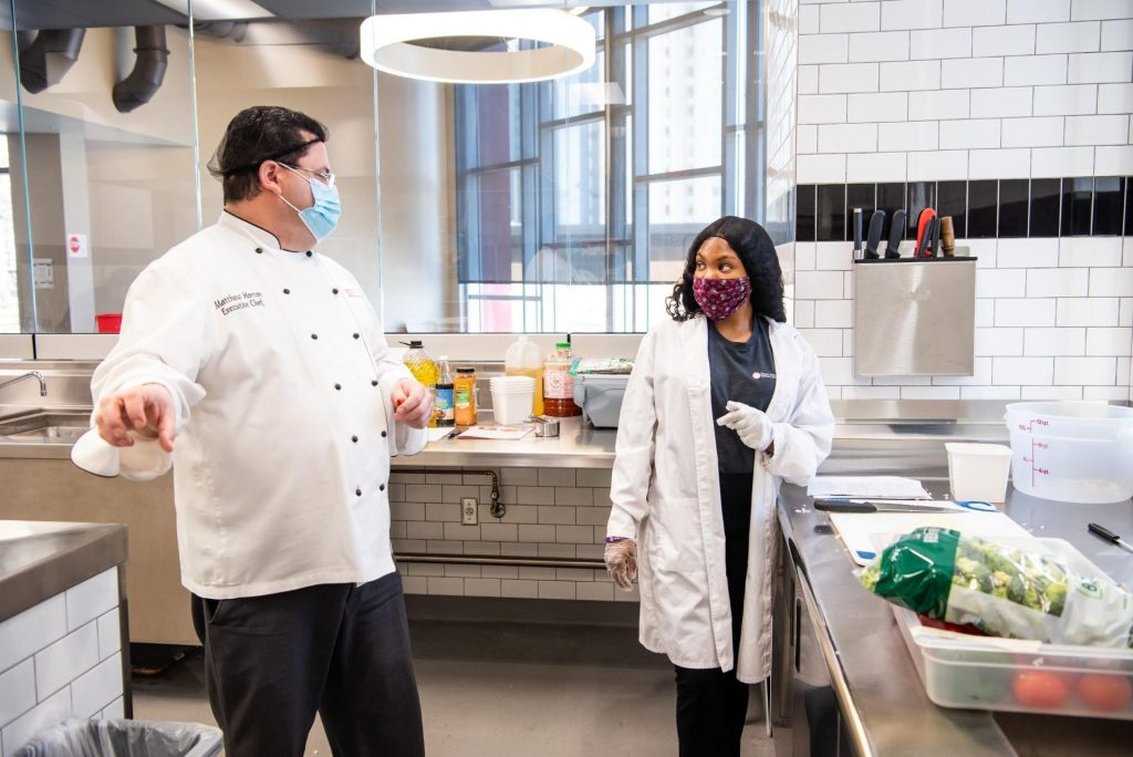 Tashaunna Divers receives mentoring from Executive Chef Matthew Horton during her internship.