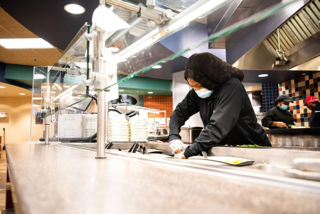In her role, Divers oversees her fellow student workers while handling tasks such as sanitizing surfaces, refilling machines, preparing food, and working in the back office.