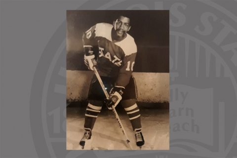 Man in black and white photo playing hockey