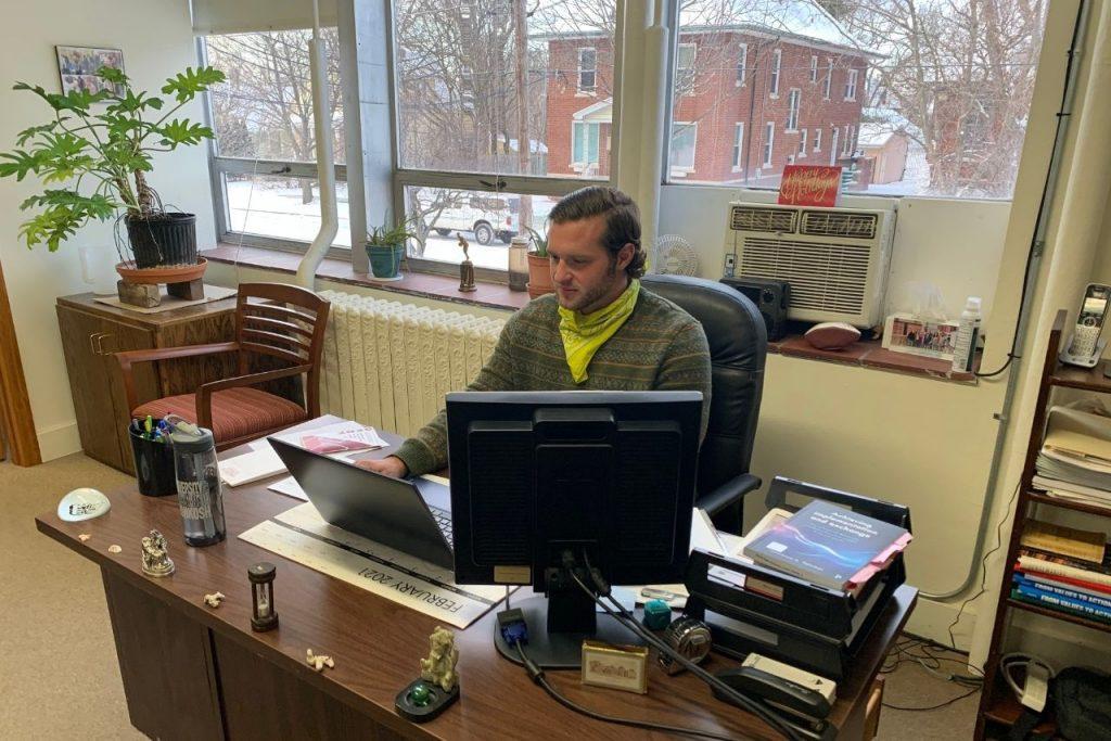 Bourke at desk