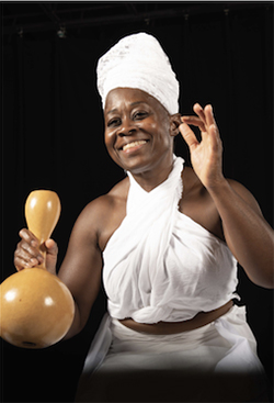 Dr. Ama Oforiwaa Aduonum with gourd instrument