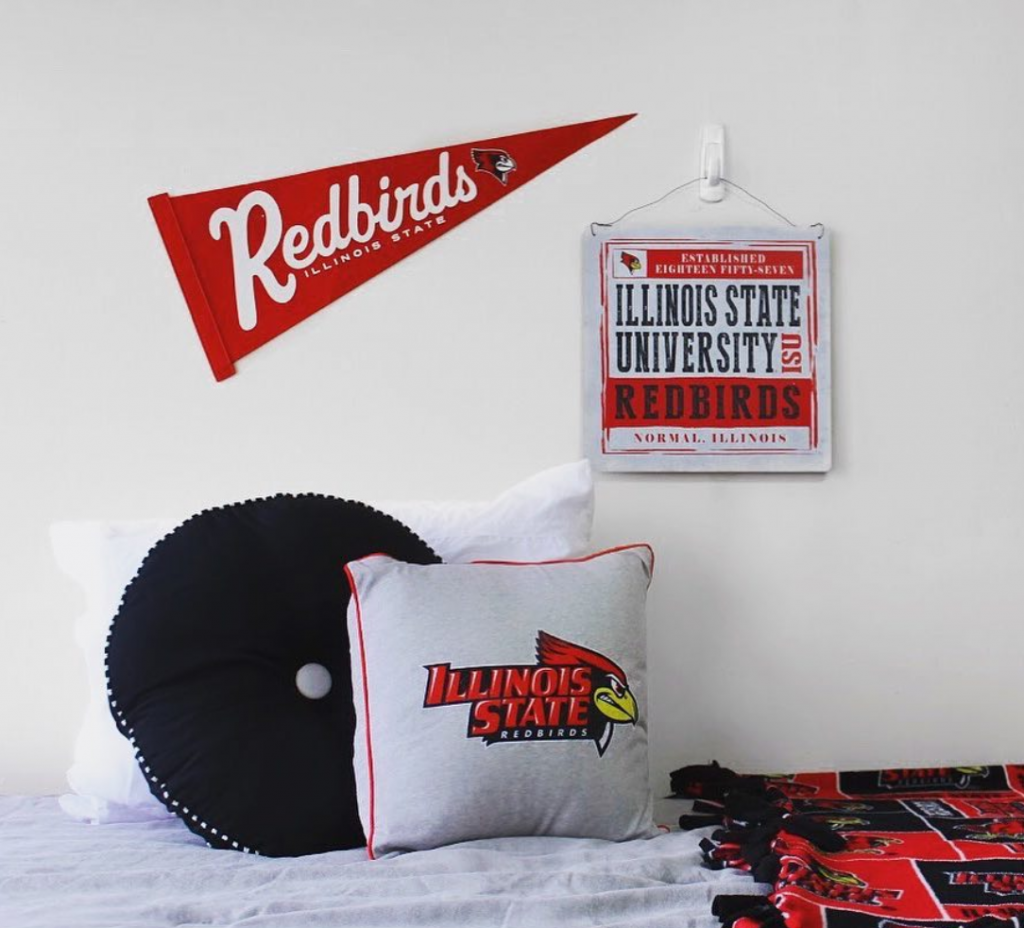 Redbird residence hall room decorated with Redbird branded accessories.
