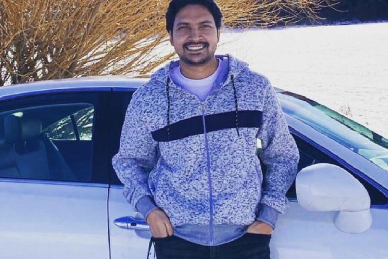 Sohel Rana standing in front of a white car