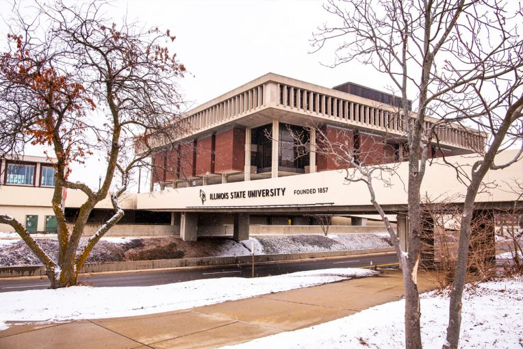 photo of the SW corner of the outsideof Milner Library with the College Avenue Bridge and trees in front