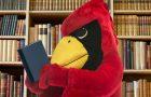 Reggie Redbird reading a book