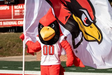 Reggie with redbird flag
