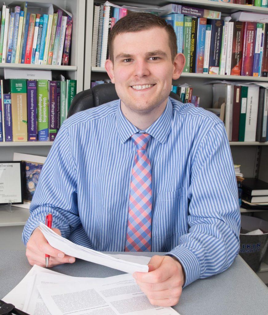John R. Blakeman, Ph.D at his desk at Illinois State University