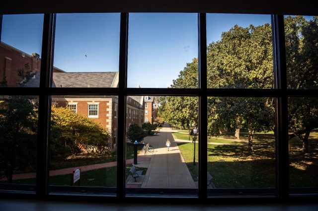 Illinois State's Quad viewed through a window in the State Farm Hall of Business