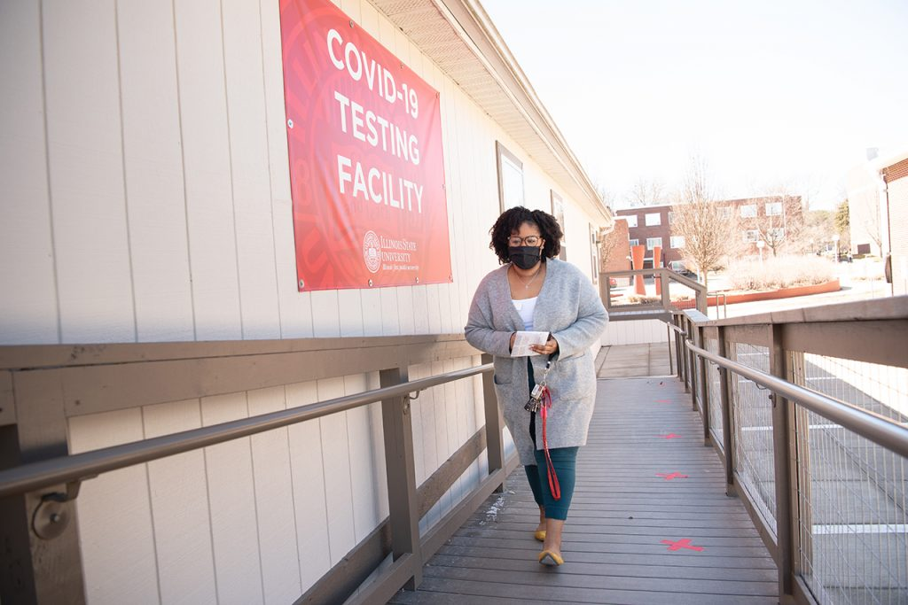 Lauren Harris receives a coronavirus test on campus.