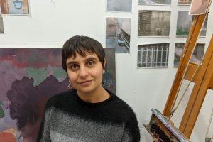 MFA Graduate Student Shahrbanoo Hamzeh in her studio. Included is some of her artwork.
