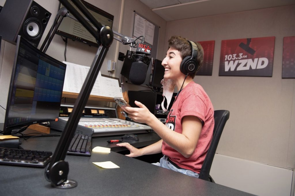 Junior media management, promotion, and sales major Sydnie Walsh works a Monday morning shift at WZND.