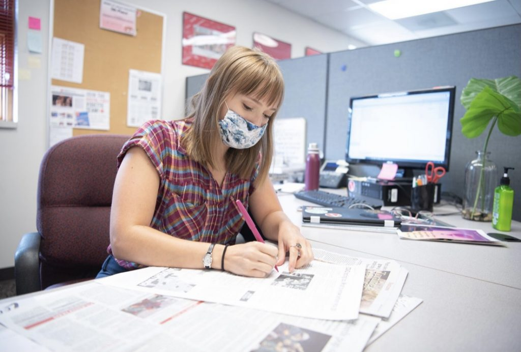 Editor in Chief Elizabeth Seils proofreads a page from the next edition of The Vidette.