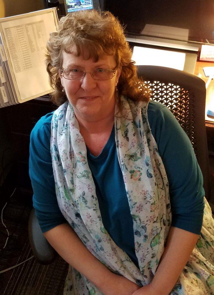 Mary Jo Kocar seated at desk