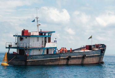 Redbird Scholar Spring 2019 cover textless showing a ship in Lake Tanganyika