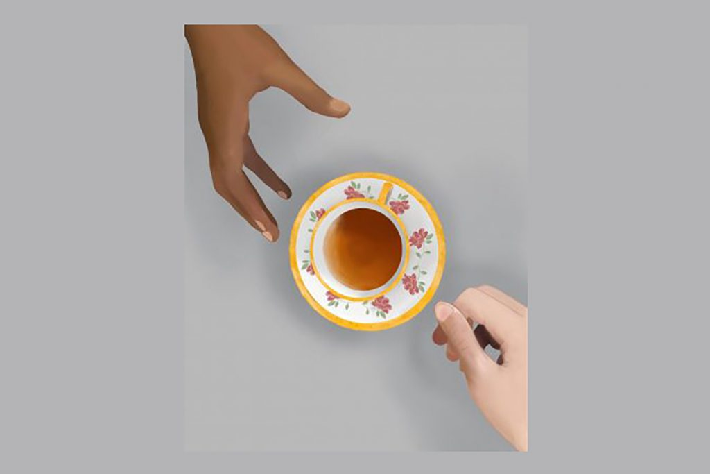 Production image for the play The DePriest Incident. Image of two hands, one white, one black passing tea.