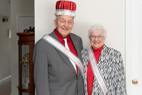 Couple in a sash and crown