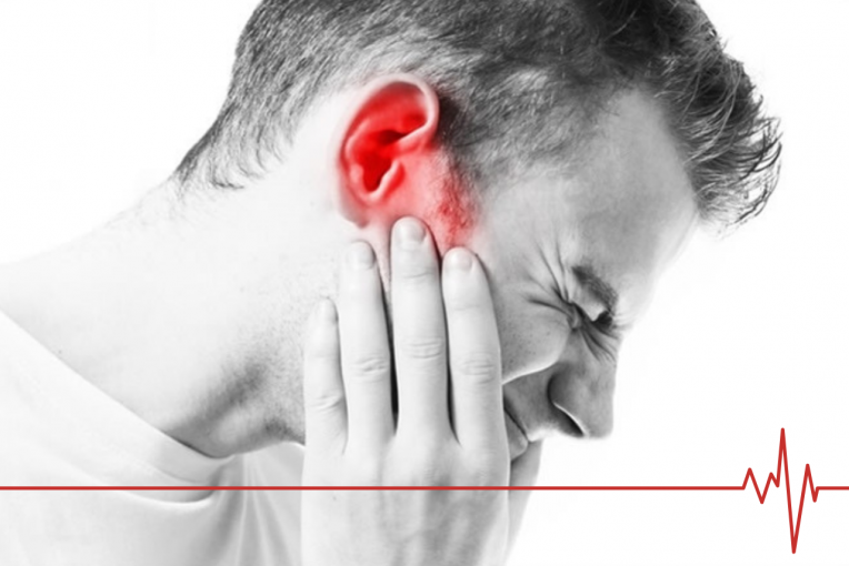 Man holding his ear. Photo is black and white, except for ear, which is in red.