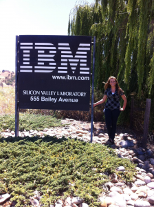 Student stands next to IBM entrance sign in California