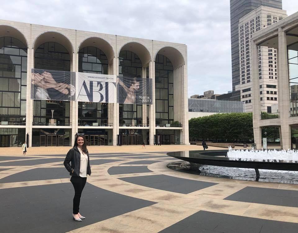 Alumna poses outside the Met Opera