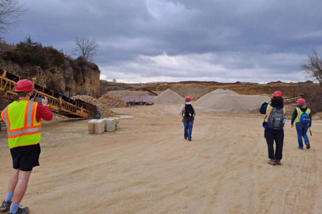 Logan Chapman (far, left) and Jackie Epperson (far, right) explore the Fischer Excavating Quarry. (Photo by Rebecca Brangard)