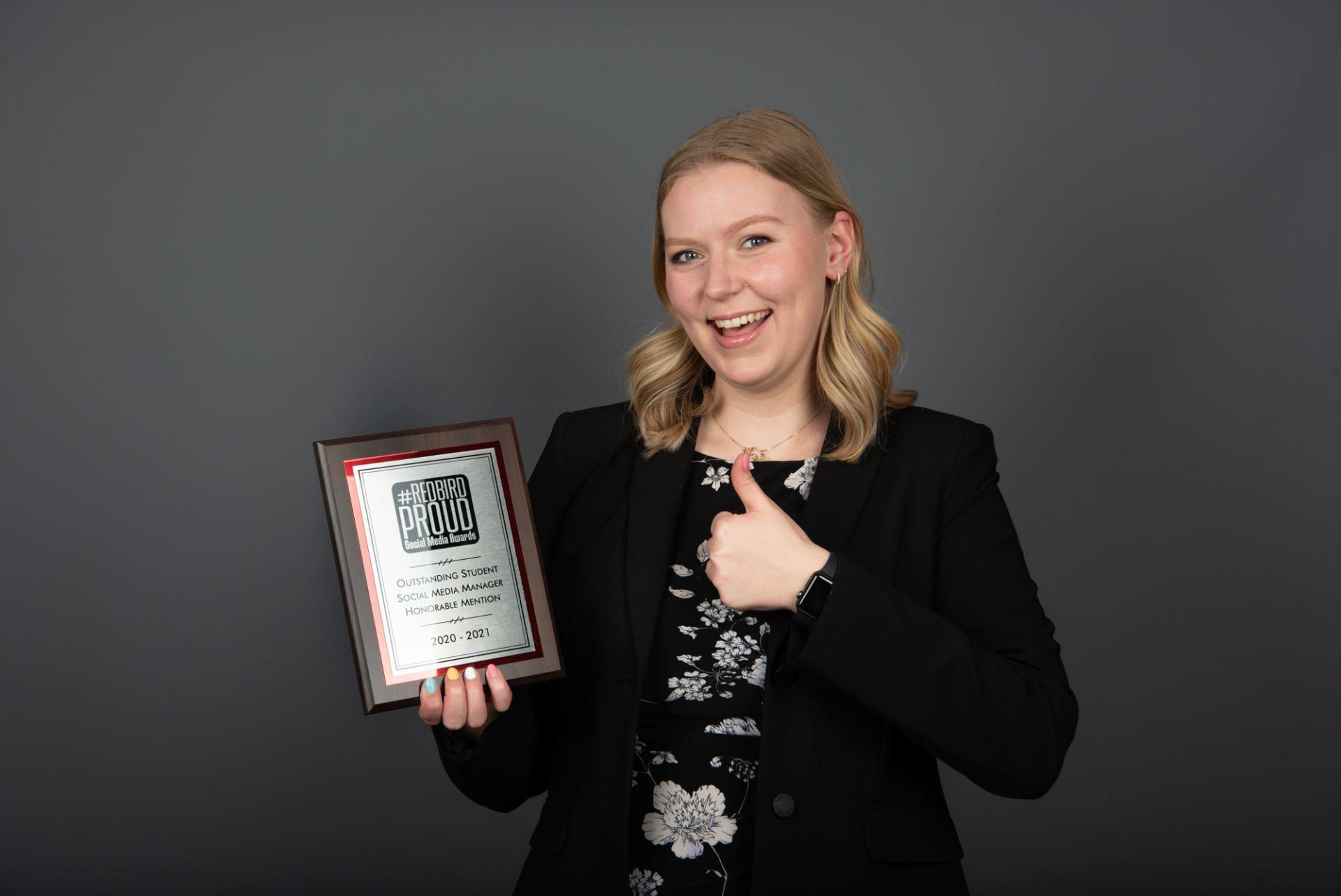 Sara Engstrom posed with award