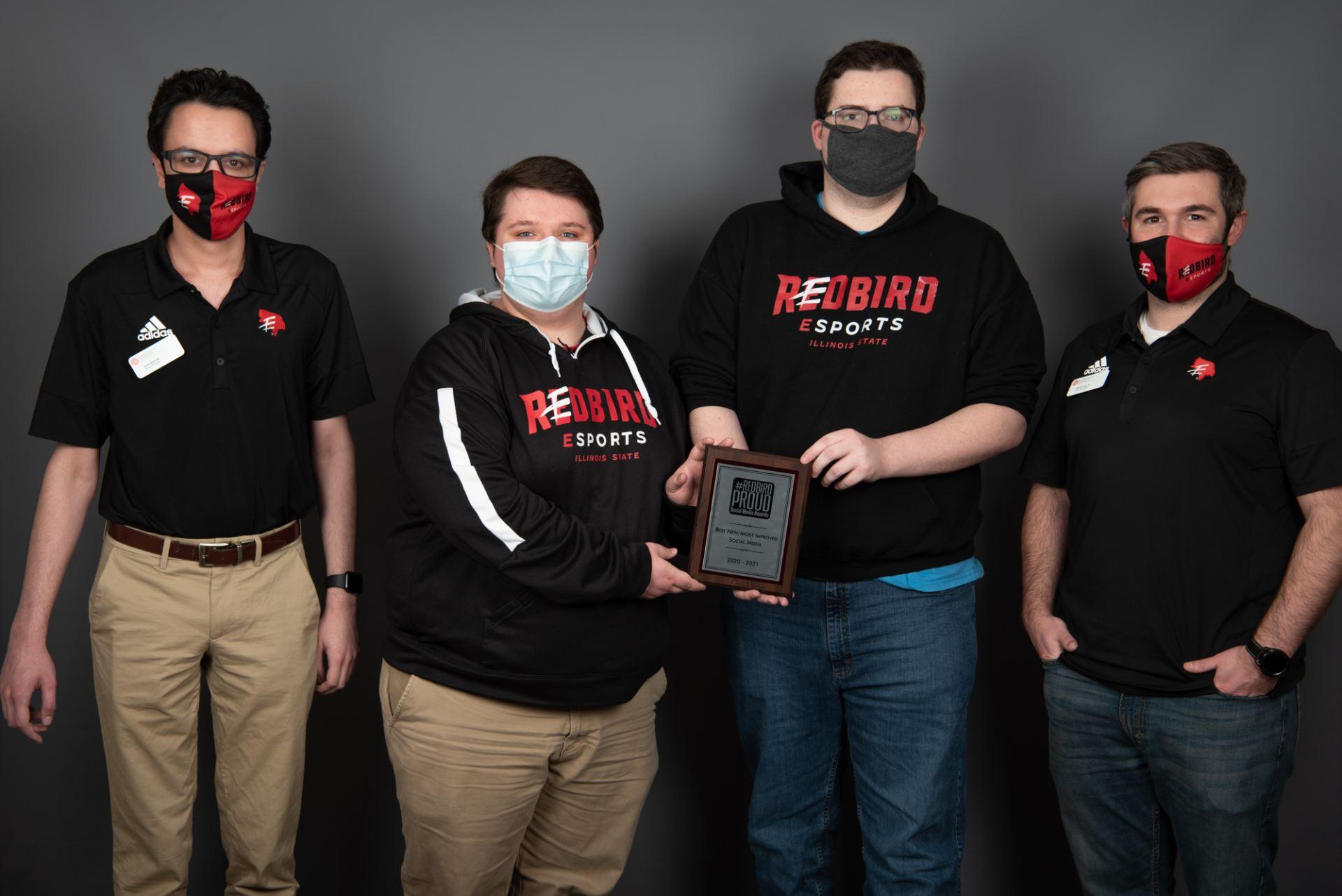 Redbird Esports posed with award