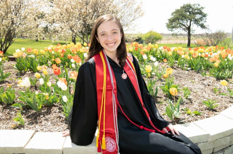 Emmi Chambers in graduation gown