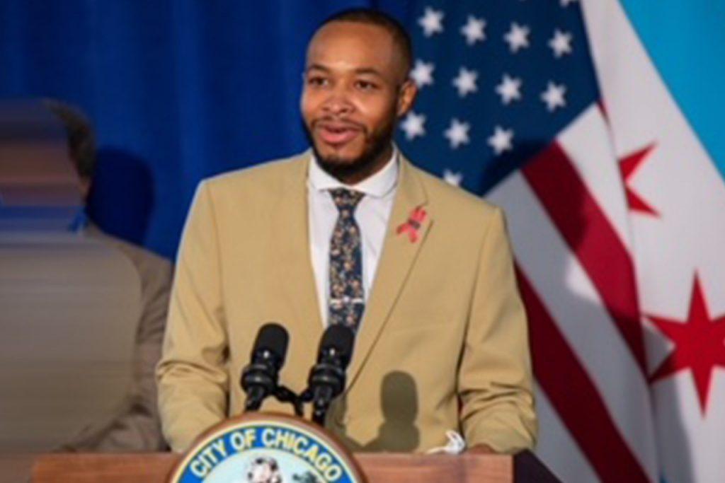 man in suit at podium