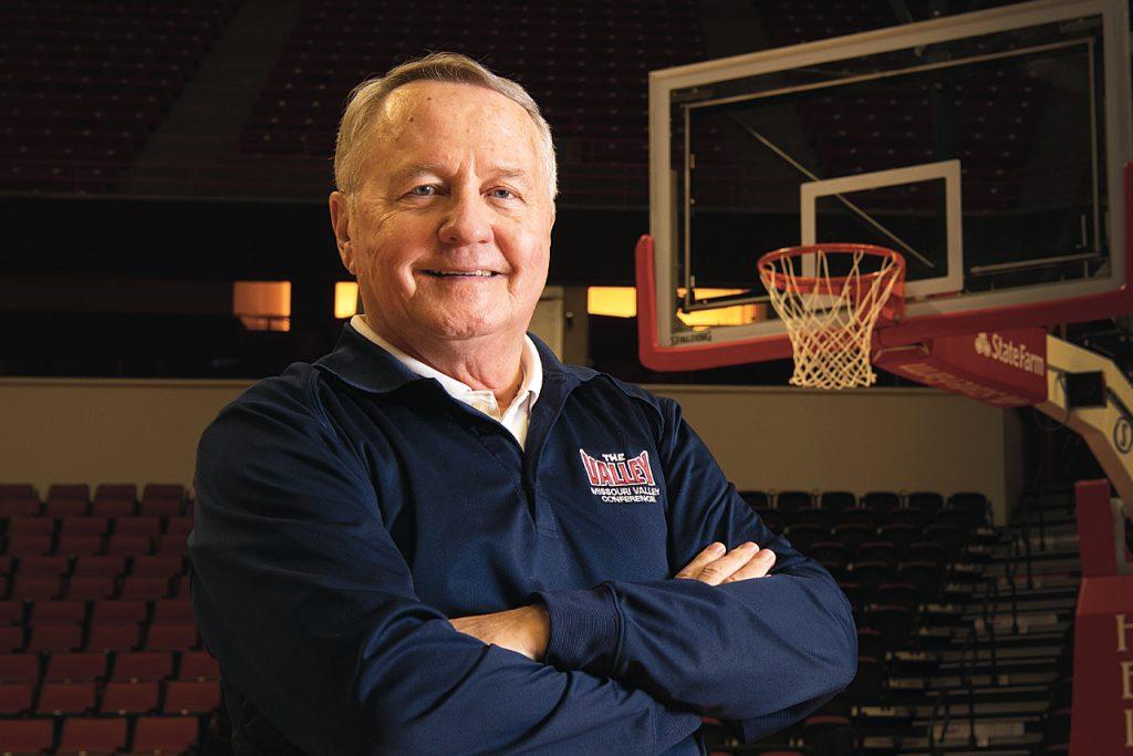 Dave Colee portrait on the Redbird basketball court