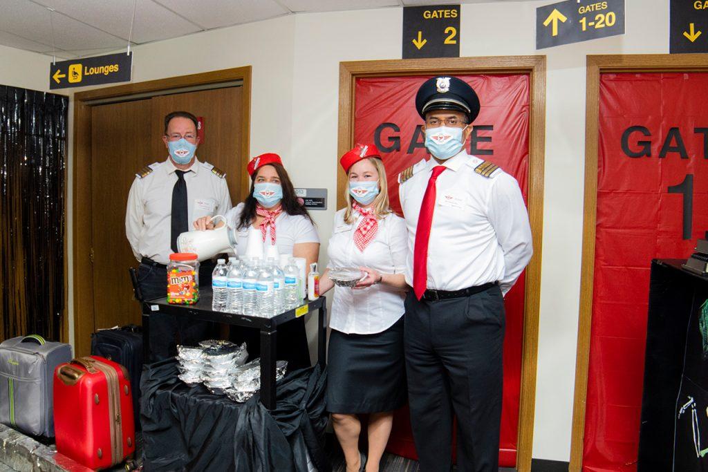 people dressed as flight attendants