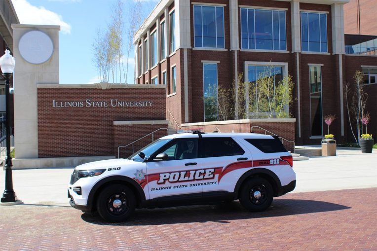 An ISU Police squad car sitting outside the Bone Student Center on a sunny afternoon