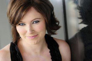 Headshot of director, Maggie Marlin-Hess