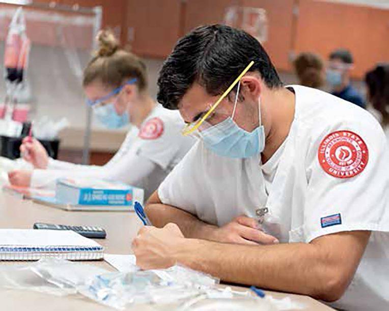 Mennonite College of Nursing students work.