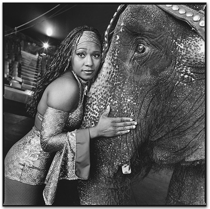 Anna Mae the Elephant hugging the trunk of her  Performing Partner Margo Porter. UniverSoul Circus, Brooklyn, New York, USA. Photographer: Mary Ellen Mark.