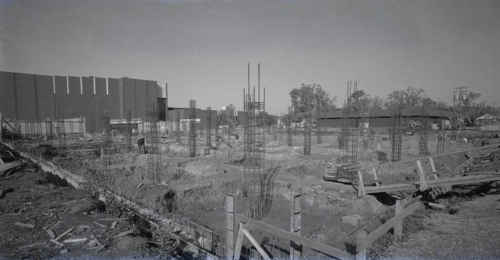Photograph of the construction of Milner Library's present building in 1972. The Bone Student Center can be seen in upper lefthand corner.