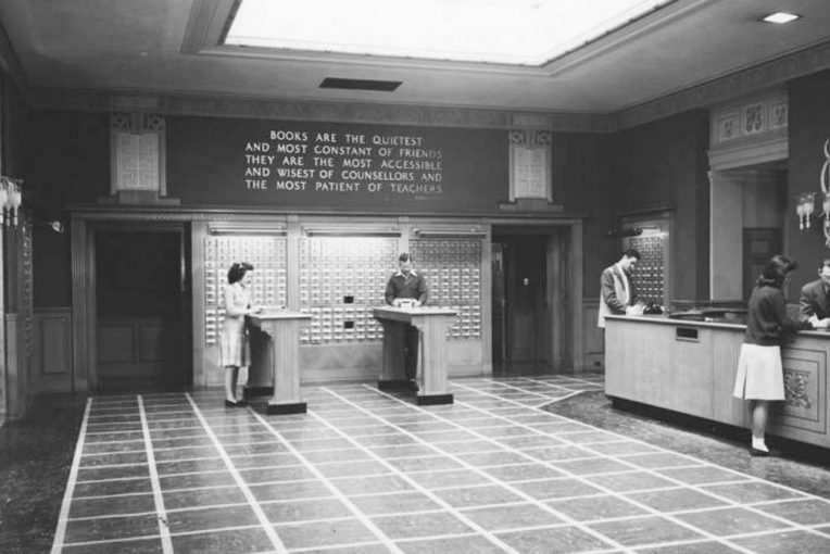 Black and white photograph of students standing at the card catalog of Milner Library when it was located in Williams Hall
