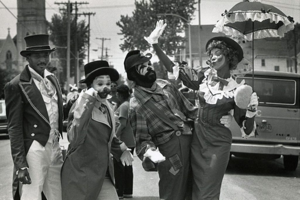 a black and white photograph of The Gilbert Troupe, a four person black circus act