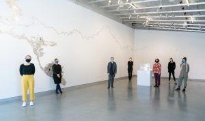 Individuals stand within University Galleries
