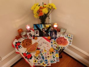 Alter with snacks, photos, candles, and cards