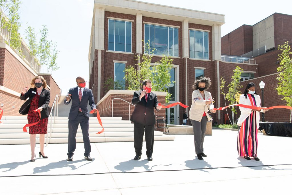 """Assistant Vice President for Student Affairs Dr. Danielle Miller-Schuster (left), Vice President for Student Affairs Dr. Levester """"L.J."""" Johnson, University President Dr. Larry H. Dietz, Board of Trustees Chairperson Julie Annette Jones, and Student Trustee Jada Turner cut the ribbon at the Bone Student Center rededication."""