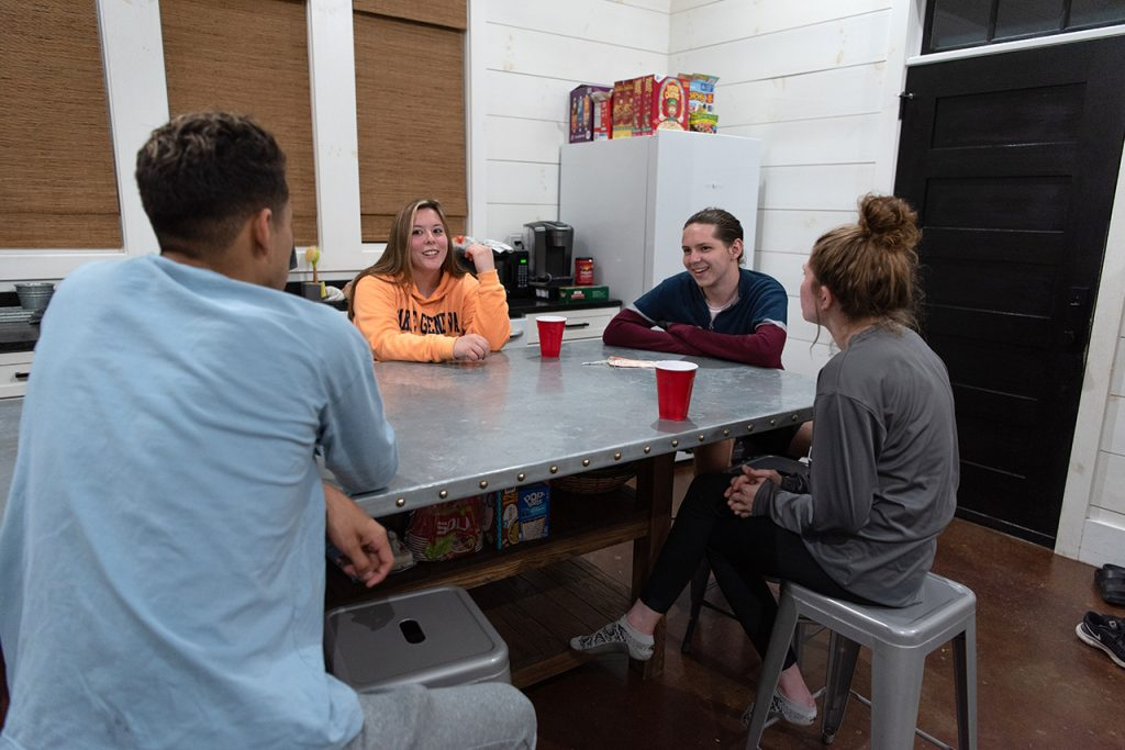 Victor Ventura (left), Anna Raymond, William Restis, and Katie Dowling discuss their highs, lows, and ways to grow during their nightly reflection.