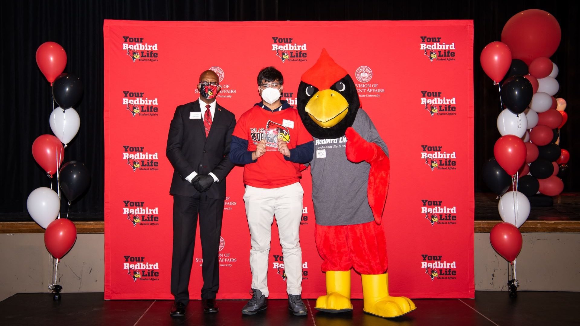 Awais Nadeem with Levester Johnson and Reggie Redbird at the Student Involvement Awards