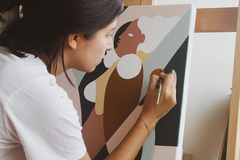 Woman painting using neutral colors