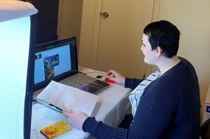 individual sitting at a laptop